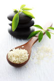 Spa Salt in Spoon and Spa Stones royalty free stock photography