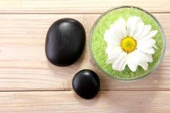 Spa salt with zen basalt stones Royalty Free Stock Photos