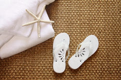 Spa sandals on sea-grass mat Stock Photo