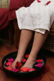 Spa scene. With legs bathed Royalty Free Stock Images