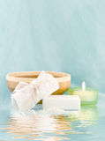 Spa scene. With candles and soap on a light blue background Stock Photos