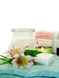 Spa Scene. With Fresh Flowers, soap and a candle Royalty Free Stock Image