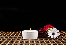 Spa  scene - aromatherapy candle and flower Royalty Free Stock Image
