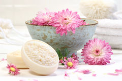Spa scene with pink  flowers in water Stock Photo
