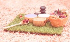 Spa Scrub salt and herb on green grass stock photos