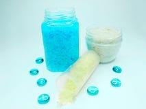 Spa sea salt among glass pebble Stock Photos