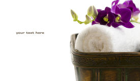 SPA set. Close up of spa towels with orchids on white  (with sample text Royalty Free Stock Photo