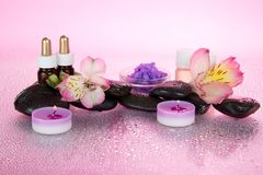 Spa set of aromatic oils, stones and candle Royalty Free Stock Images