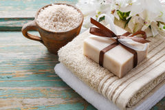 Spa set: bar of handmade natural soap lying on the towels royalty free stock images