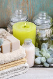 Spa set: bar of soap, towels, scented candle, liquid soap Royalty Free Stock Image