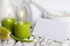Spa set with blank paper card. Spa set with candles and blank paper card with copyspace Royalty Free Stock Image