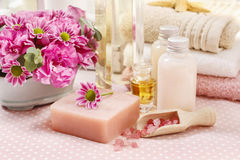 Spa set: bottle of essential oil, liquid soap, scoop of raspberr Royalty Free Stock Image