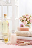 Spa set: bottle of essential oil, liquid soap, scoop of raspberr Stock Photography