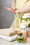 Spa set: bottle of essential oil, soft towels, bar of natural, h Royalty Free Stock Photo
