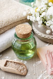 Spa set: bottle of essential oil, soft towels, bar of  soap Stock Photos