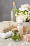 Spa set: bottle of essential oil, soft towels, bar of  soap Royalty Free Stock Images