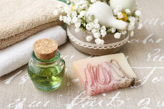 Spa set: bottle of essential oil, soft towels, bar of  soap Stock Image