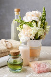 Spa set: bottle of essential oil, soft towels, bar of  soap Royalty Free Stock Photos