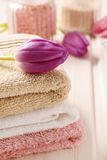 Spa set: bouquet of tulips on a towel, sea salts and bar of soap Royalty Free Stock Photo