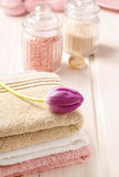 Spa set: bouquet of tulips on a towel, sea salts and bar of soap Royalty Free Stock Image