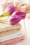 Spa set: bouquet of tulips on a towel, sea salts and bar of soap Stock Photo