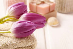 Spa set: bouquet of tulips on a towel, sea salts and bar of soap Stock Image