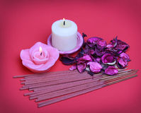 Spa Set. Burning candles with roses dried leaves, incense sticks Stock Photo