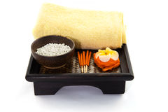 Spa Set. flower Shaped Candles, incense sticks. On white background Royalty Free Stock Image