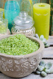 Spa set: green sea salt, scented candles, liquid soap and essent Stock Photos