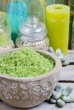 Spa set: green sea salt, scented candles, liquid soap and essent Stock Photos