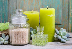 Spa set: green sea salt, scented candles, liquid soap and essent. Ial oils. Relax time Royalty Free Stock Image
