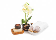 Spa set isolated .Orchid flower with towels, soap and candle bur Stock Photo
