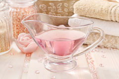 Spa set: liquid soap, scented candles, towels and rose sea salt Stock Photography