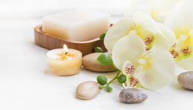 Spa set with orchid, candle and massage stones Royalty Free Stock Images