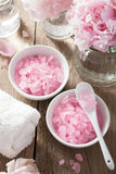 Spa set with peony flowers and pink herbal salt Royalty Free Stock Photo