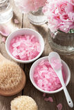 Spa set with peony flowers and pink herbal salt Royalty Free Stock Photos