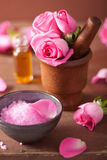 Spa set with pink rose flowers mortar and herbal salt Royalty Free Stock Photography