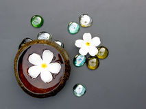 Spa set with Plumeria flower water in coconut shell Royalty Free Stock Photos
