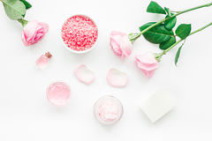 Spa set with rose flowers and cosmetic for body on white desk background top view. Spa set with rose flowers and cosmetic for body care on white desk background Royalty Free Stock Photos