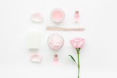 Spa set with rose flowers and cosmetic for body on white desk background top view. Spa set with rose flowers and cosmetic for body care on white desk background Royalty Free Stock Photography