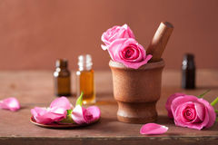 Spa set with rose flowers mortar and essential oil Royalty Free Stock Image