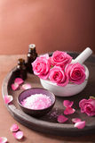 Spa set with rose flowers mortar essential oils salt Stock Images