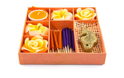 Spa Set. Roses Shaped Candles, incense sticks in orange box Royalty Free Stock Images