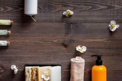 Spa set with salt and cosmetics on wooden table background top view copyspace Stock Image