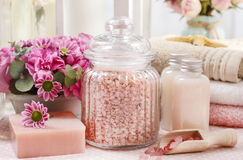 Spa set: sea salt, bar of handmade natural soap, liquid soap, es Royalty Free Stock Photo