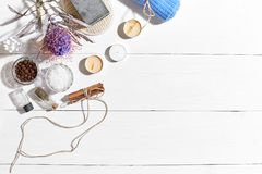 Spa set with sea salt, essential oil, soap and towel decorated with dry flower on white wooden background Royalty Free Stock Photography