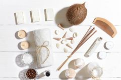 Spa set with sea salt, essential oil, soap and towel decorated with seashells on white wooden background Royalty Free Stock Photography