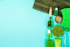 Spa set: soap, mask, oil, sea salt and towel on blue background Stock Images