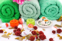 Spa set. With towels, candles, flowers and stones closeup picture Royalty Free Stock Photography