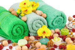Spa set. With towels, candles, wooden balls and flowers closeup picture Stock Photos